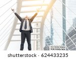 celebrating success. low angle... | Shutterstock . vector #624433235