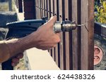 man hands drilling wooden fence ... | Shutterstock . vector #624438326