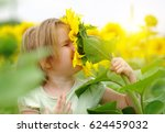 happy little girl smelling a... | Shutterstock . vector #624459032