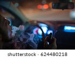 the man smoke in the car.... | Shutterstock . vector #624480218