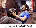 muscular man doing exercise...   Shutterstock . vector #624495602