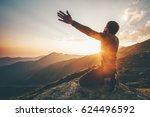 man praying at sunset mountains ... | Shutterstock . vector #624496592