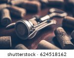 corkscrew and wine corks on... | Shutterstock . vector #624518162
