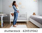 mother comforting newborn baby... | Shutterstock . vector #624519362