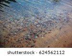 underwater pebbles in the river....   Shutterstock . vector #624562112