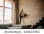 woman doing yoga in the attic... | Shutterstock . vector #624615452