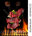flying pieces of raw steaks ... | Shutterstock . vector #624646112
