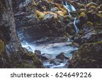Waterfall Among Rocks And...