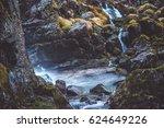 Waterfall Among Rocks And...