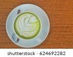 top view of hot matcha tea and...   Shutterstock . vector #624692282