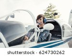 smiling female pilot in the... | Shutterstock . vector #624730262