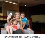 happy family siting on sofa and ...   Shutterstock . vector #624739862