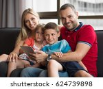 happy young family playing... | Shutterstock . vector #624739898