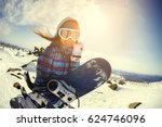 Girl Snowboarder Enjoys The Sk...