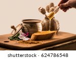 liquid honey and toast on a... | Shutterstock . vector #624786548