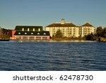 Large boat shelter and apartment building - stock photo