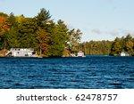 Boathouse on a lake - stock photo