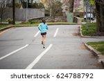 Lone Jogger In A Bike Lane.
