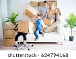 family unpacking boxes | Shutterstock . vector #624794168