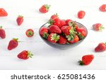 Red Strawberries On A White...