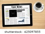 a tablet showing 'fake news' as ... | Shutterstock . vector #625097855