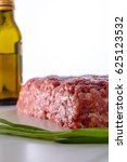 raw minced meat with green... | Shutterstock . vector #625123532