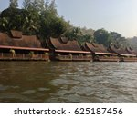 Small photo of Traditional wodden lakehouse of Thailand near the river.