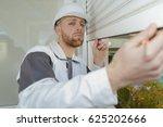 worker installing rolling...   Shutterstock . vector #625202666