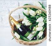white basket with bottle of... | Shutterstock . vector #625260488