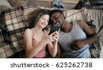 multiethnic couple lying on bed ... | Shutterstock . vector #625262738