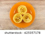 Orange Glass Plate With Pasta...
