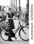 blonde girl and retro bike | Shutterstock . vector #625428242
