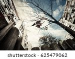 young man doing parkour jump ... | Shutterstock . vector #625479062