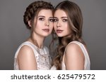 two beautiful girls looking at...   Shutterstock . vector #625479572