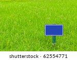 blue sign label on green grass | Shutterstock . vector #62554771