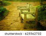 wooden park bench in the garden | Shutterstock . vector #625562732
