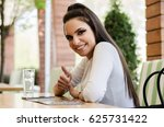 girl in a restaurant or a cafe... | Shutterstock . vector #625731422