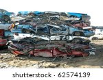 Damaged Squashed Cars In A Jun...
