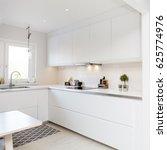 Small photo of white kitchen interior counter top