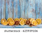 dried oranges on a wooden... | Shutterstock . vector #625939106
