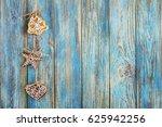 gingerbread on blue wooden... | Shutterstock . vector #625942256