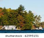 Colorful boathouses on  a lake shore - stock photo