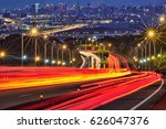 blurred tail lights and traffic ... | Shutterstock . vector #626047376