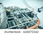 Small photo of Aircraft engine detail. Piece of equipment of the aircraft engine closeup. View of an aircraft engine.