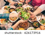 nice family having tasty dinner | Shutterstock . vector #626173916
