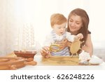 mom and child making model ship....   Shutterstock . vector #626248226