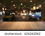 empty wooden table in front of... | Shutterstock . vector #626262062
