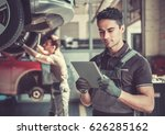 at the auto service. handsome... | Shutterstock . vector #626285162