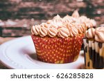 tasty cupcakes on a old wooden... | Shutterstock . vector #626285828
