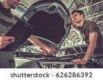 handsome young auto mechanics... | Shutterstock . vector #626286392